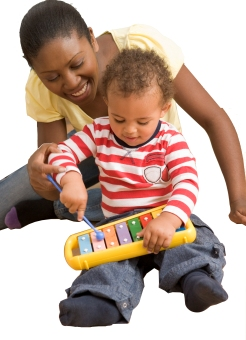 Toddler sitting with mom playing xylophone